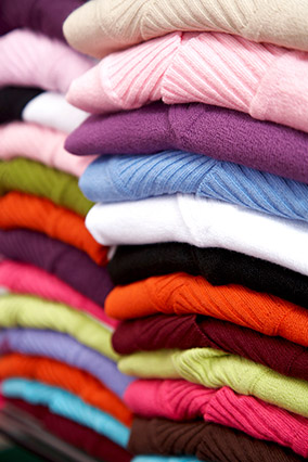 Pile of colorful sweaters