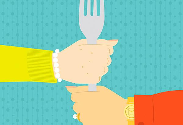 Hands holding fork