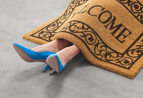 Woman under a doormat