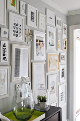 Framed photo collage in entryway