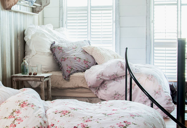 Floral bedding in a shabby chic bedroom paradise.