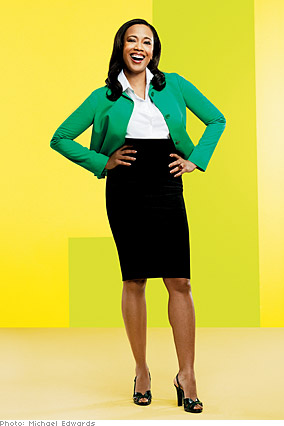 Donna in a black pencil skirt and brightly colored cardigan