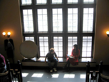 Angie Harmon and photographer sitting in front of windows