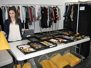 Fashion assistant organizes for photo shoot