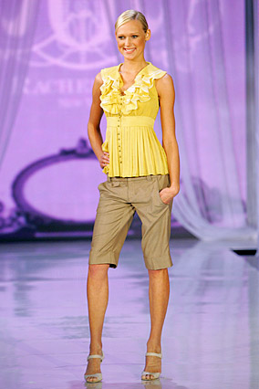 Rachel Roy's yellow blouse and khaki short pants