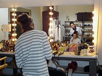 Hairstylist Hikari combs Mia Maestro's hair.