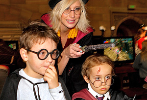 Children and mom in Harry Potter costumes
