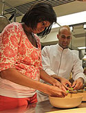 Michelle Obama and assistant White House chef Sam Kass