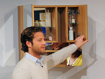 Nate Berkus opens the IKEA Ekholmen Mirrored Cabinet.