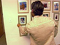 Learn how to hang framed pictures on the wall.