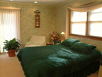 The green bedroom before Nate Berkus's makeover.