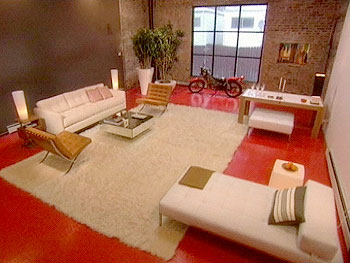 Sexy orange painted floors spices up a loft