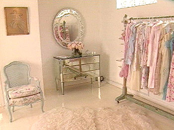 Rachel's master bedroom is filled with frilly touches and mirrors.