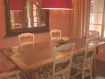 Actress Marg Helgenberger dines in a pumpkin dining room.
