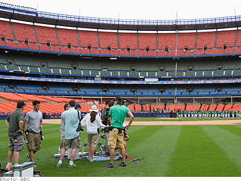 Camera crews set up for a shoot at Shea Stadium.