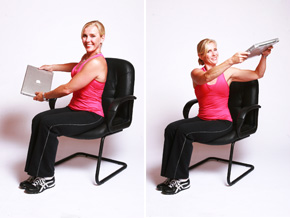 Andrea Metcalf demonstrates the spine rotation exercise with a laptop.