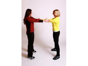 Andrea Metcalf demonstrates the partner push.