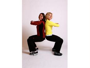 Andrea Metcalf demonstrates the partner squat.