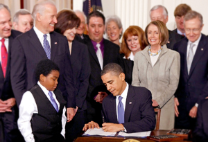 President Barack Obama signs the Affordable Health Care for America Act at a March 23, 2010, ceremony in the White House.