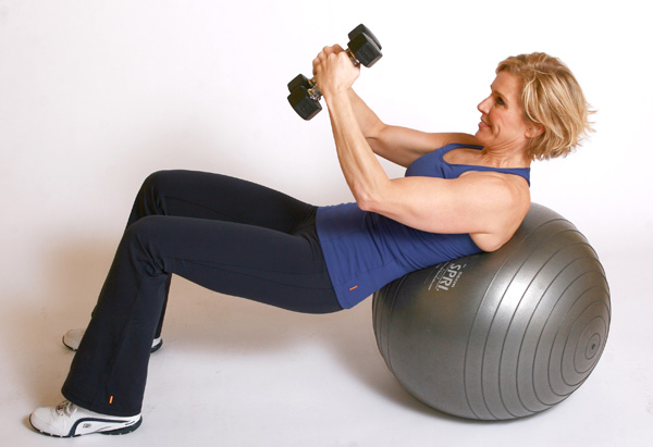 Andrea Metcalf demonstrates the oblique twist exercise.