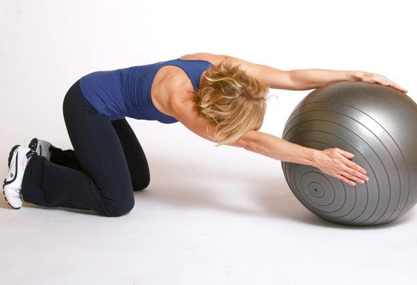 Andrea Metcalf demonstrates the side oblique roll exercise.