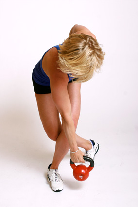 Andrea Metcalf demonstrates how to do the curtsy row exercise using a kettlebell.