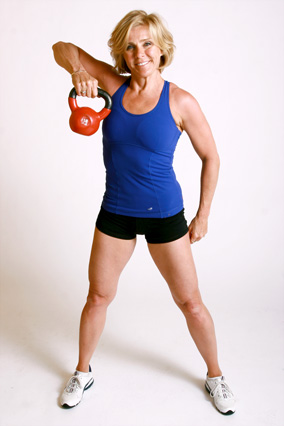 Andrea Metcalf demonstrates how to do the curtsy row exercise using a kettlebell