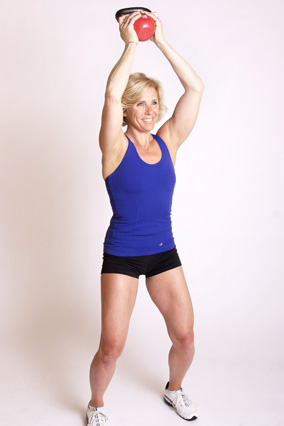 Andrea Metcalf demonstrates how to do the oblique lean exercise using a kettlebell.