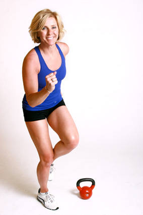 Andrea Metcalf demonstrates how to do the power hop exercise using a kettlebell.