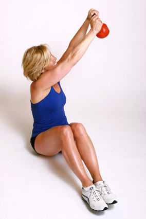 Andrea Metcalf demonstrates how to do the seated shaker exercise using a kettlebell.