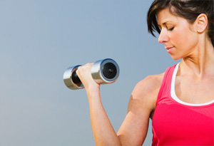 Woman lifting weights.