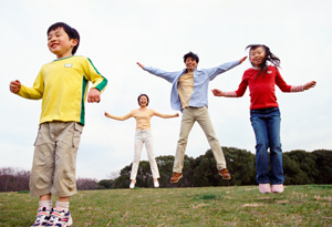 Jumping jacks are a great outdoor family activity.