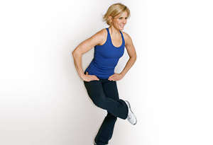 Andrea Metcalf demonstrates the crossed leg stretch.