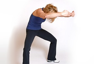 Andrea Metcalf demonstrates the lower back rounded stretch.