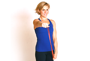 Andrea Metcalf demonstrates the shoulder shaper exercise.
