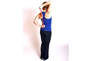 Andrea Metcalf demonstrates the tricep toner exercise.