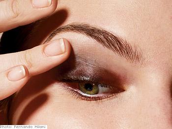 Blend color on eyelids.