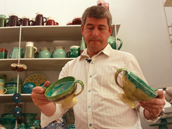Keith Johnson looking a ceramics in Argentina