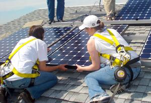Simran's students install solar panels.