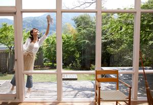 Woman washing windows outside