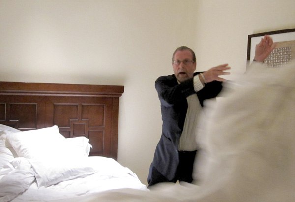 Peter Greenberg demonstrates how he deals with dirty hotel bedspreads.