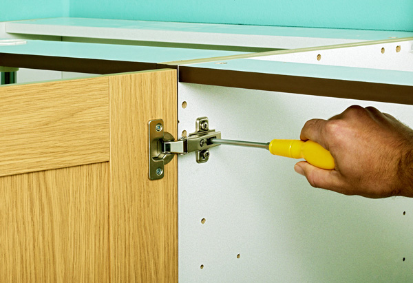 Fixing the hardware on kitchen cabinet