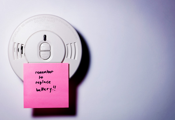 Smoke detector with sticky note