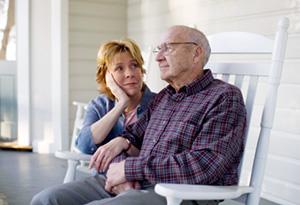 A caregiver talking to an elderly parent