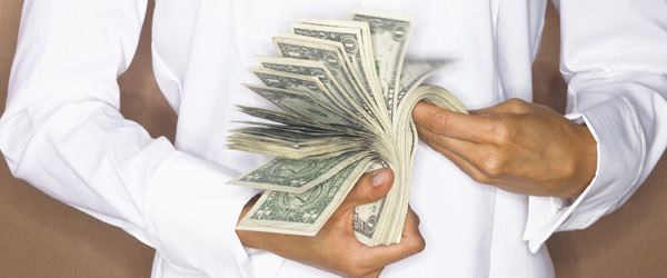 Woman holding cash dollars