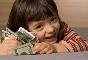 Young girl smiling with money