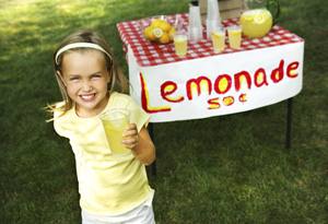Young girl selling lemonade