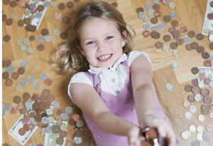 Girl laying on floor surrounded by money