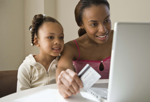 Mom and daughter paying with credit card