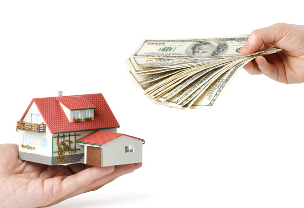 Man holding money, man holding small house